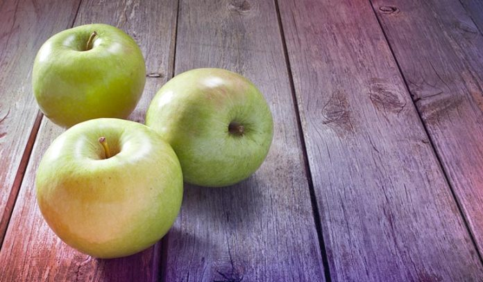 Smooth, uniformly colored apples are sweet and ripe
