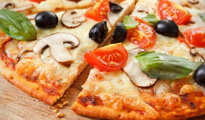 A slice of wild mushroom pizza makes a light and tasty dinner option