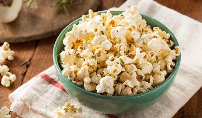 Popcorn sprinkled with some herbs and spices can make a great snack