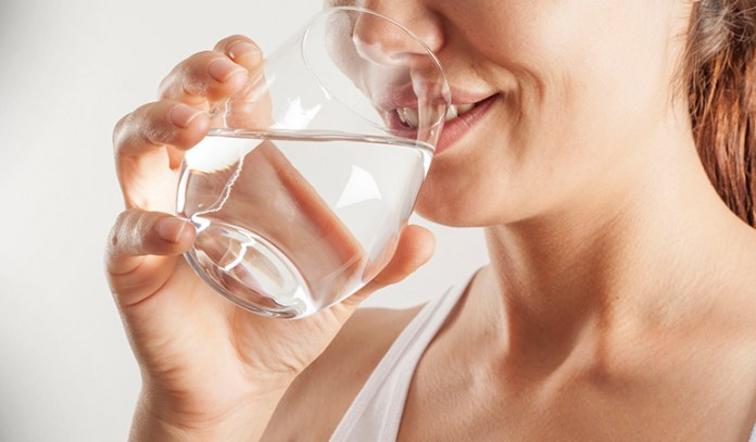 To reduce bloating during your period, drink plenty of water