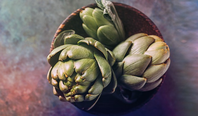 There's 4.86 gm of protein in a cup of artichoke hearts.