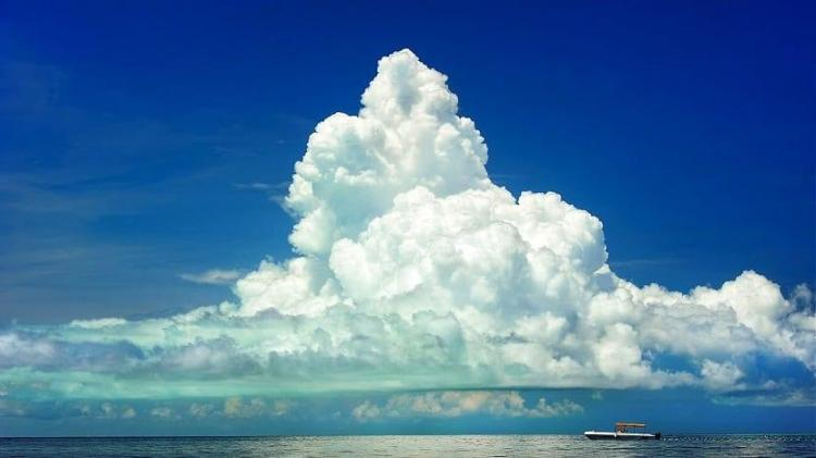 A large, pyramid shaped cloud, formed above the sea
