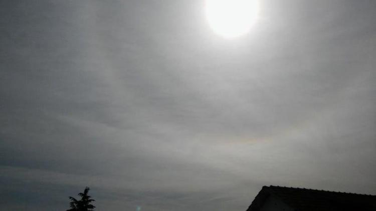A veil like Cirrostratus type clouds formig a halo in the sky