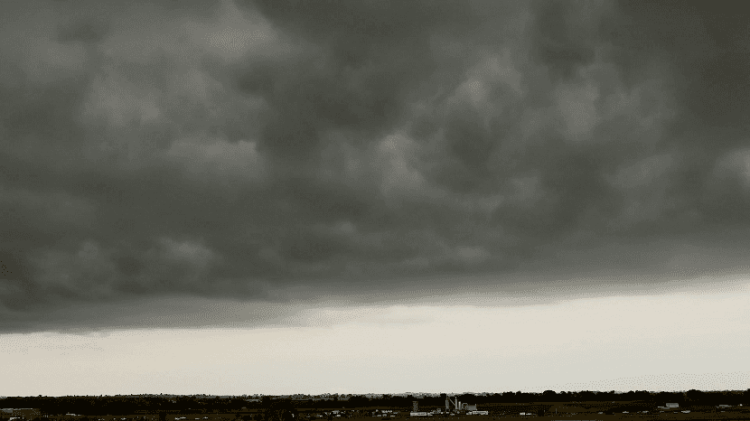 Heavy and gray multi - level clouds of Nimbostratus tyoe