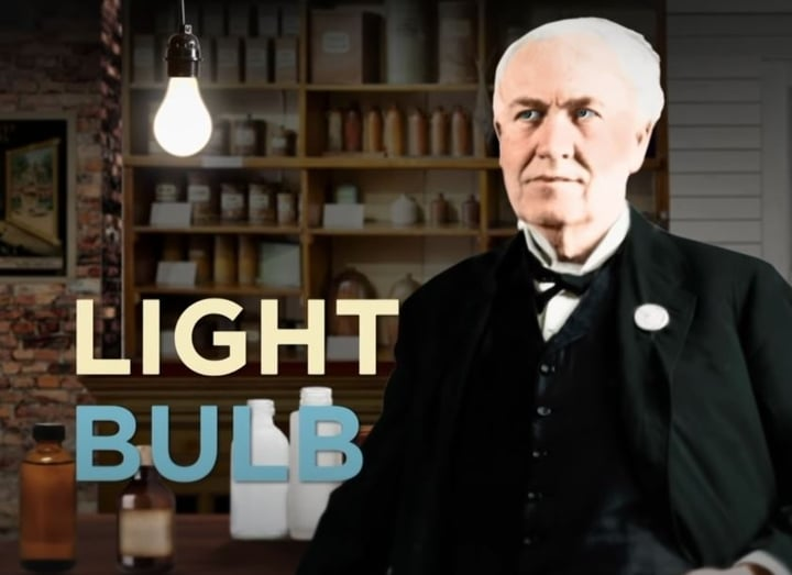 Picture of Thomas Edison inventing the light bulb.
