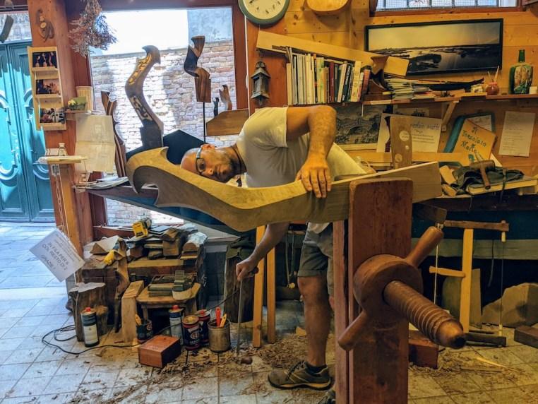 Venice artisan creating a forcola