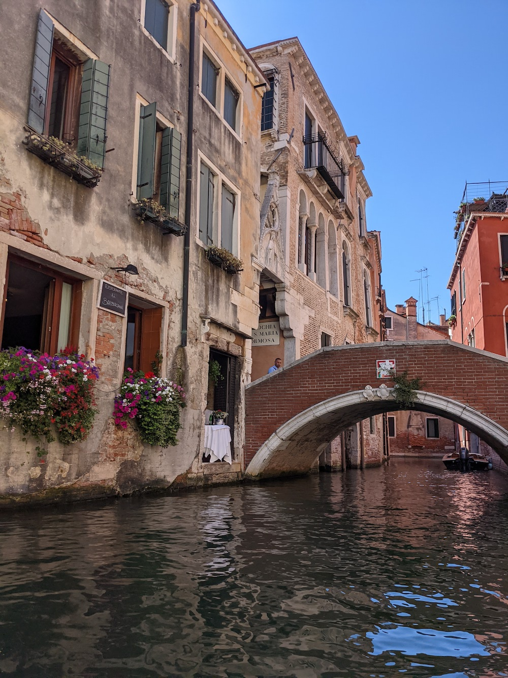 Charming Venice Canal with restaurant and bridge