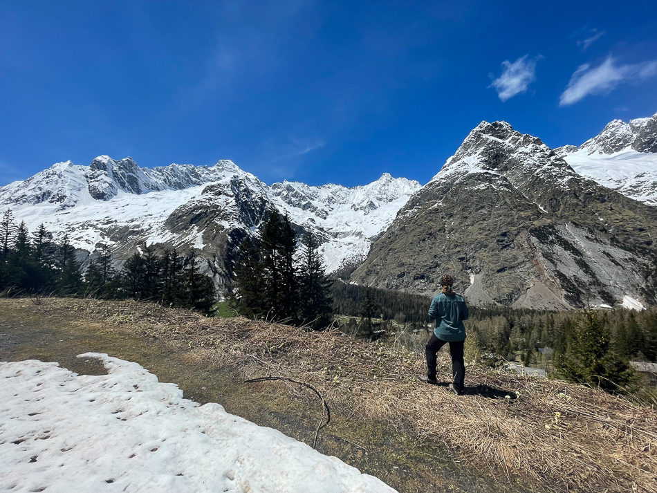 girl hiking in the Switzerland snow-covered mountains la Fouly