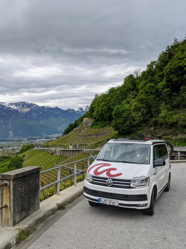 campervan and vineyards on a road trip itinerary for Switzerland