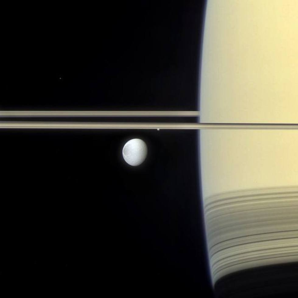 Saturn and its moon Dione.