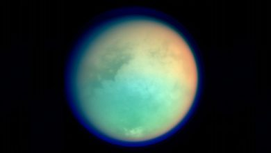 This undated NASA handout shows Saturn's moon, Titan, in ultraviolet and infrared wavelengths. The Cassini spacecraft took the image while on its mission to. gather information on Saturn, its rings, atmosphere and moons. The different colors represent various atmospheric content on Titan. Image Credit: NASA.