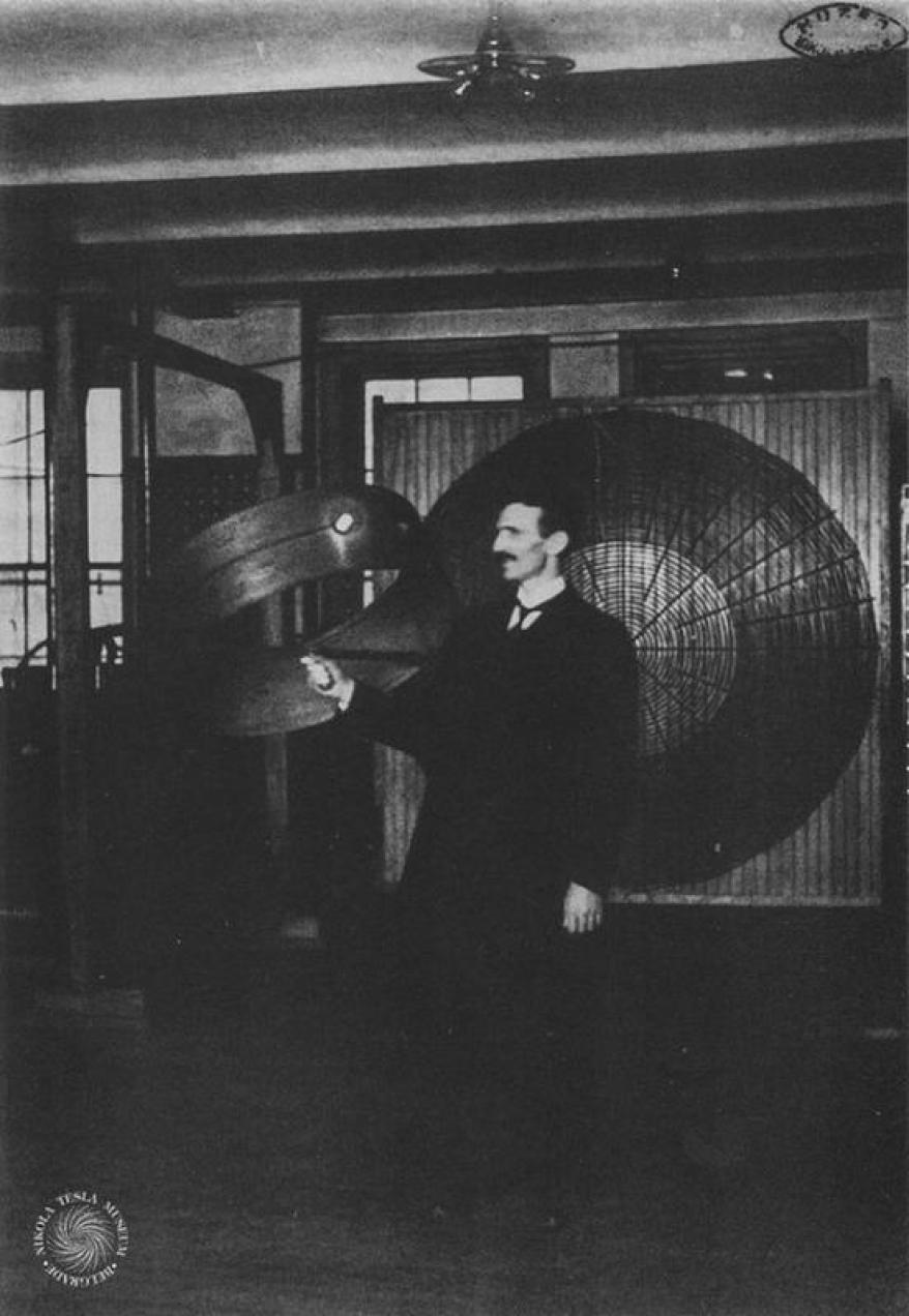 A photograph taken in 1899 shows Nikola Tesla showing off wireless power transmission.
