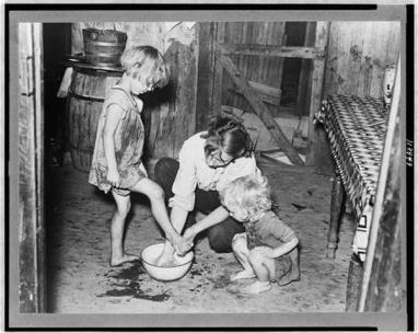mother-washing-feet-and-cleaning-up-daughters-in-sharecroppers-shack-southeast-missouri-farmse2808f