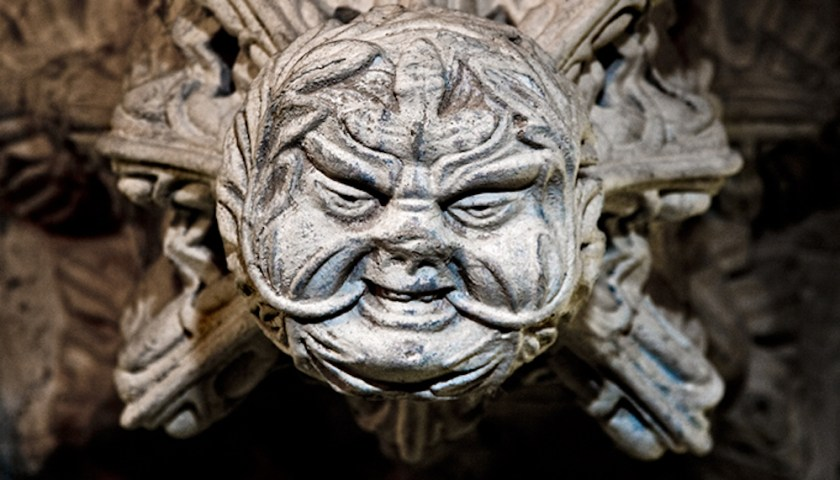 Rosslyn Chapel Green Man with round face. Leaves growing from mouth.