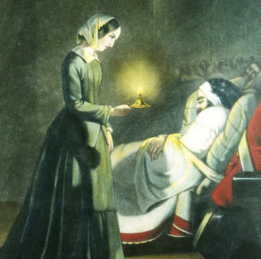 Florence Nightingale with lamp checking on patient