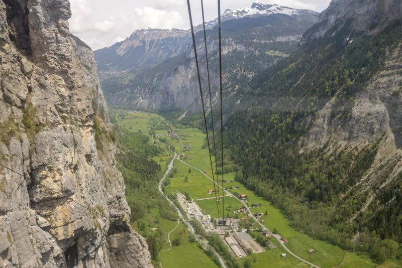 Cable car above Stechelberg village, Switzerland. Looking down into Lauterbrunnen valley