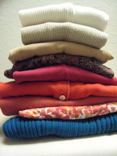 the pile of sweaters, clean & ready for... storage/re-design/trash??