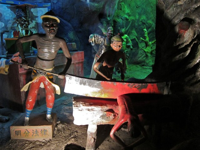 Ten courts of hell at Haw Par Villa in Singapore | curlytraveller.com