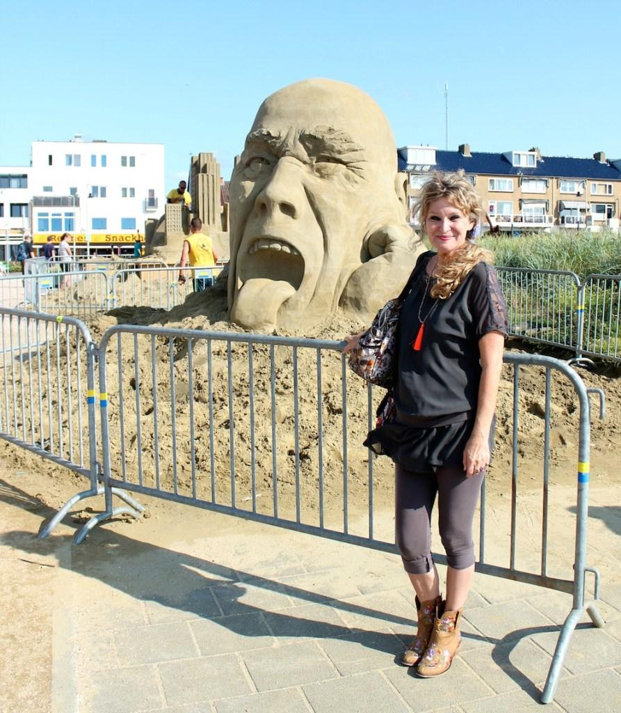 woman in front of sand sculpture