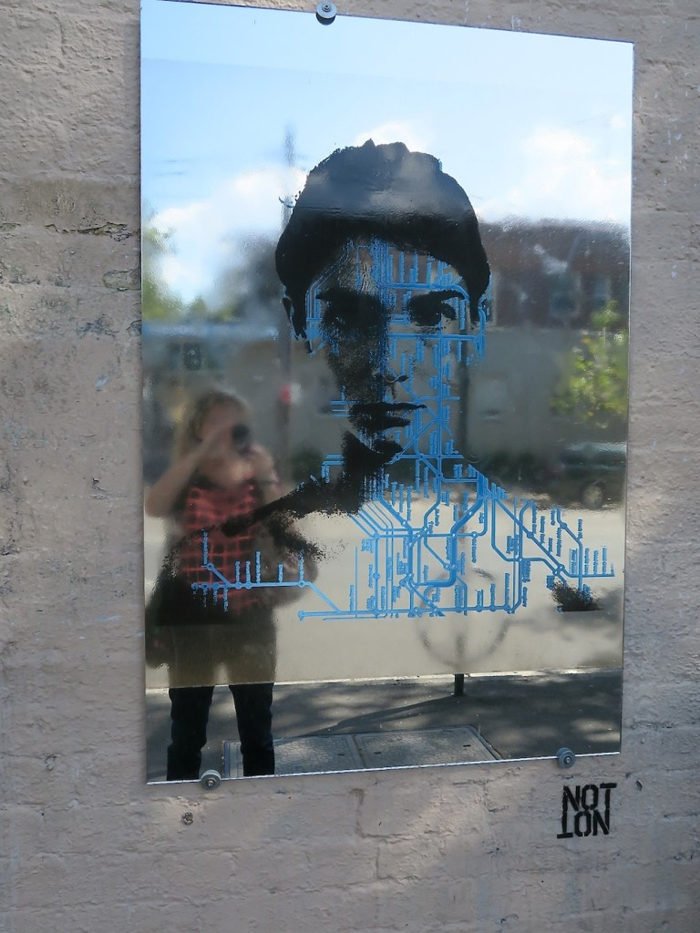 Street art with a mirror and a public transport map in Sydney|curlytraveller.com
