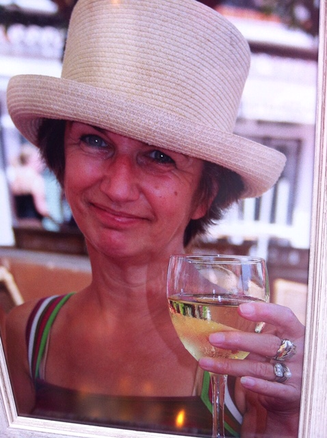 Woman with hat and drink |curlytraveller.com