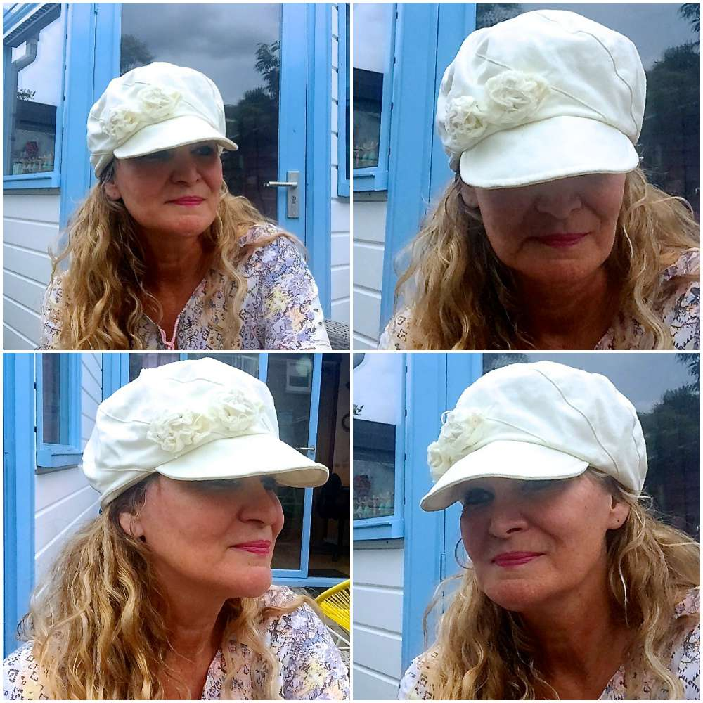woman wearing a white newsboy hat |curlytraveller.com