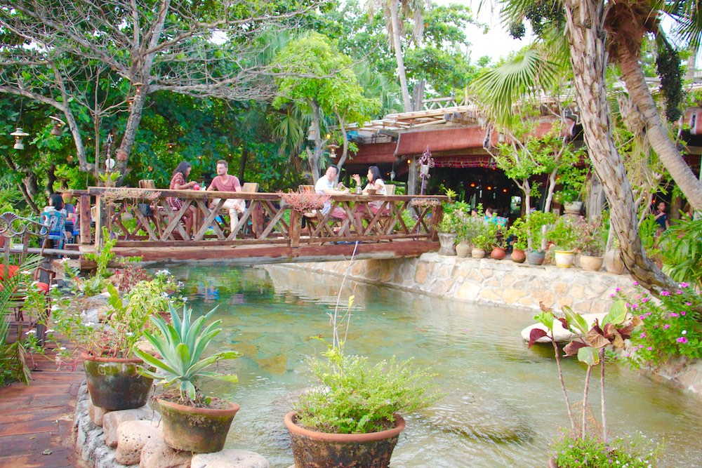 Seating on a small bridge at La Laguna Bali |curlytraveller.com