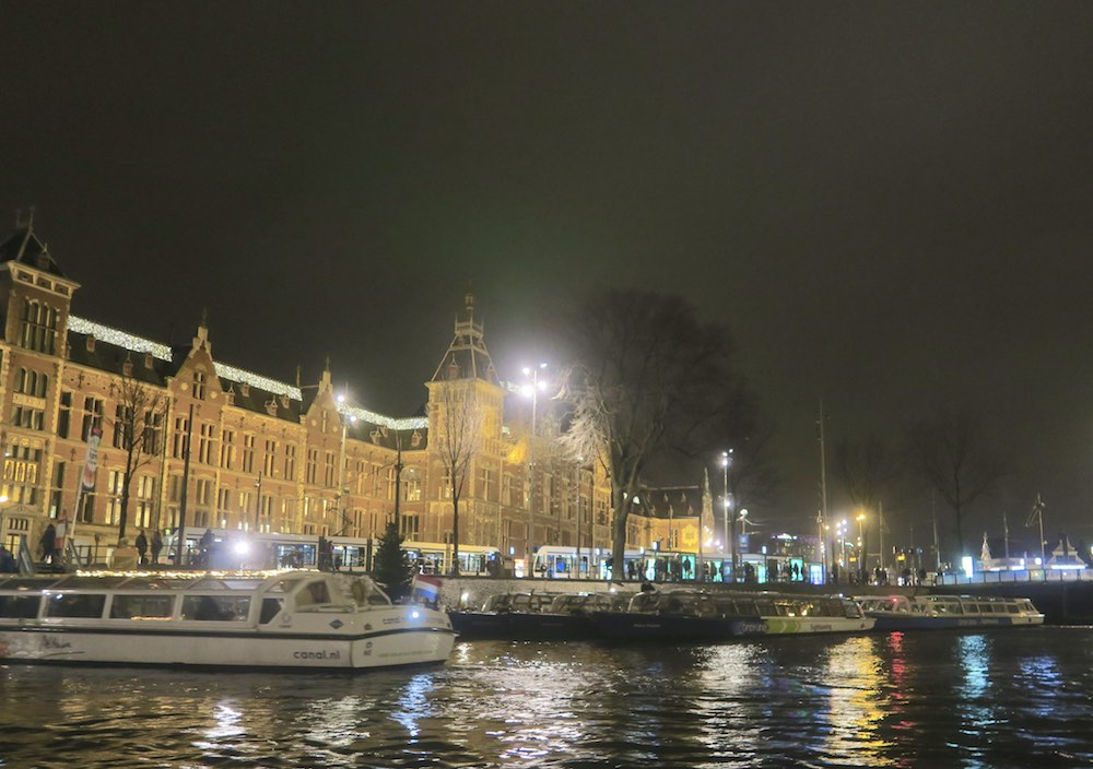 Canal boats in front of Amsterdam's Central Station |curlytraveller.com