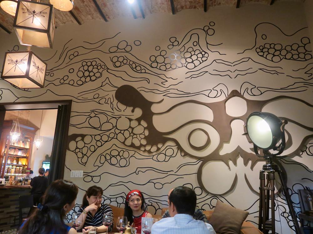 Wall and lights in Cafe Runam Saigon |curlytraveller.com