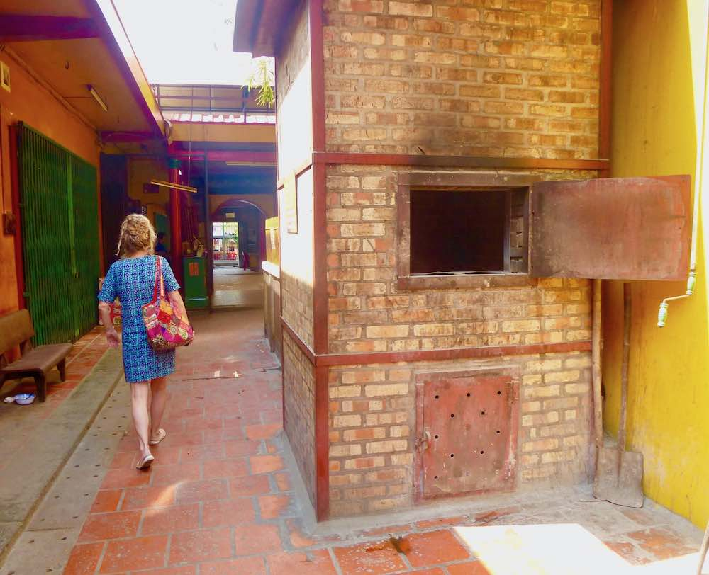 Woman walks out of temple in Cholon |curlytraveller.com