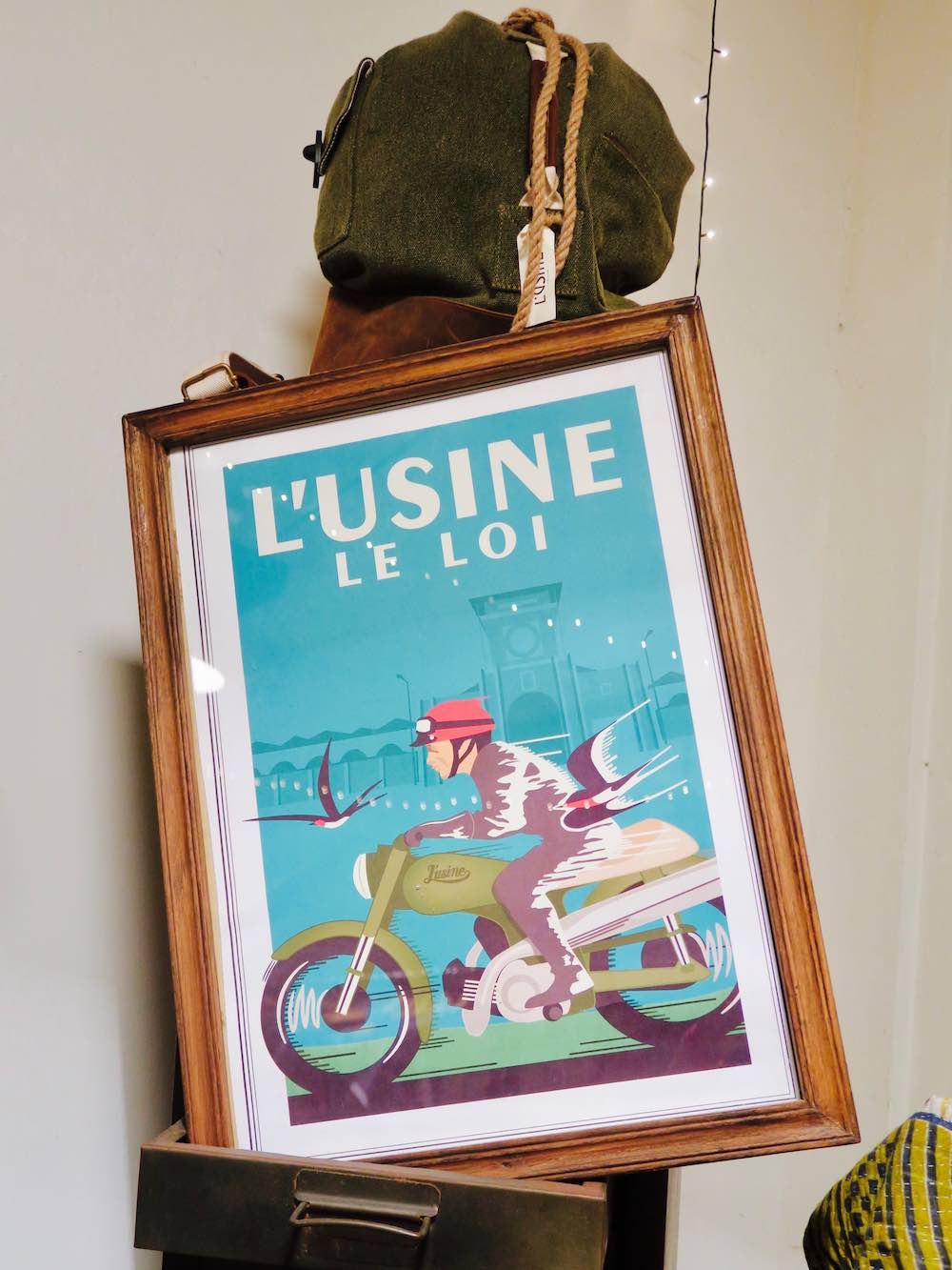 Logo and poster of L'Usine le Loi Saigon |curlytraveller.com
