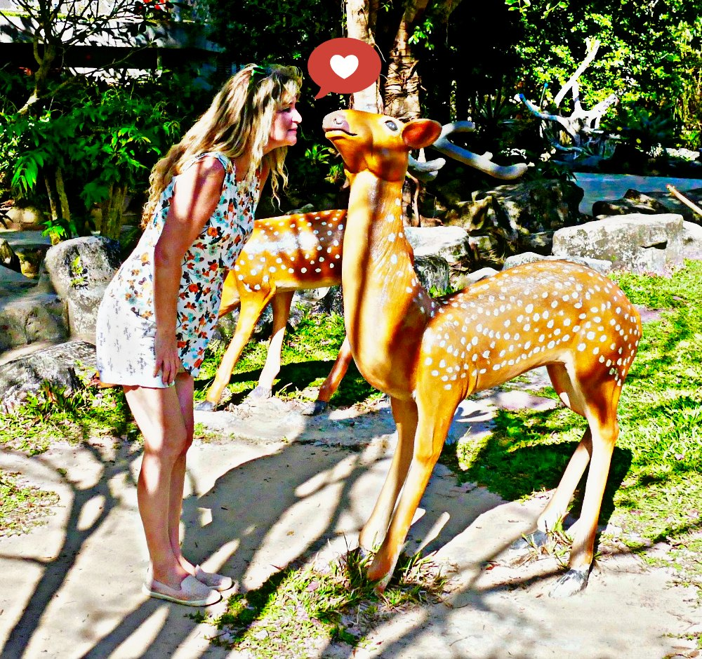 Woman kissing a deer statue on Phu Quoc Vietnam |curlytraveller.com