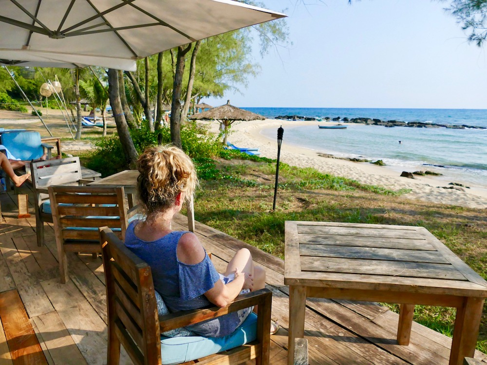 Woman in bar at Mango Bay Resort |curlytraveller.com