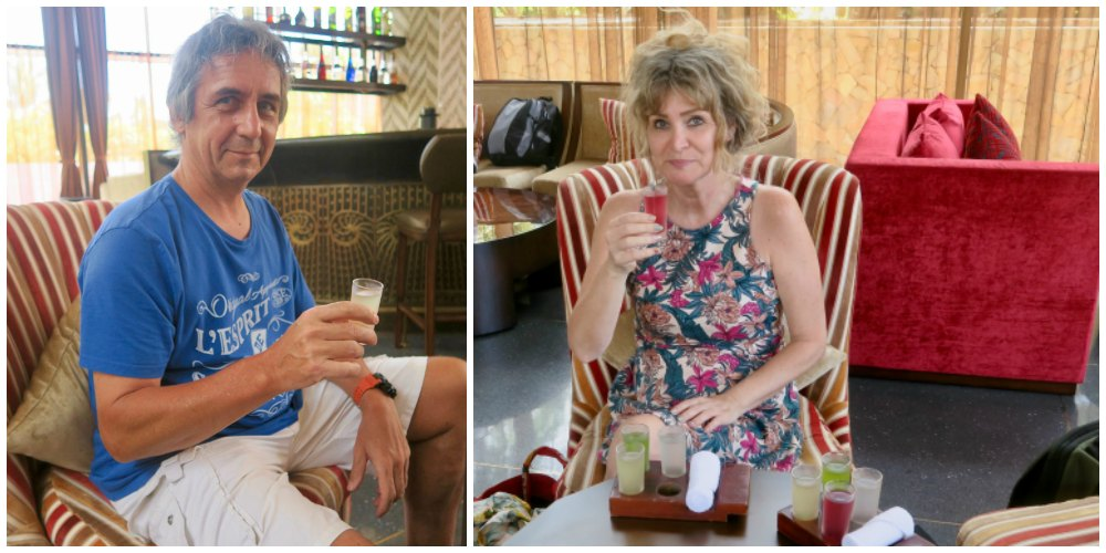 Couple drinking aromatic cold teas at Salinda Resort |curlytraveller.com