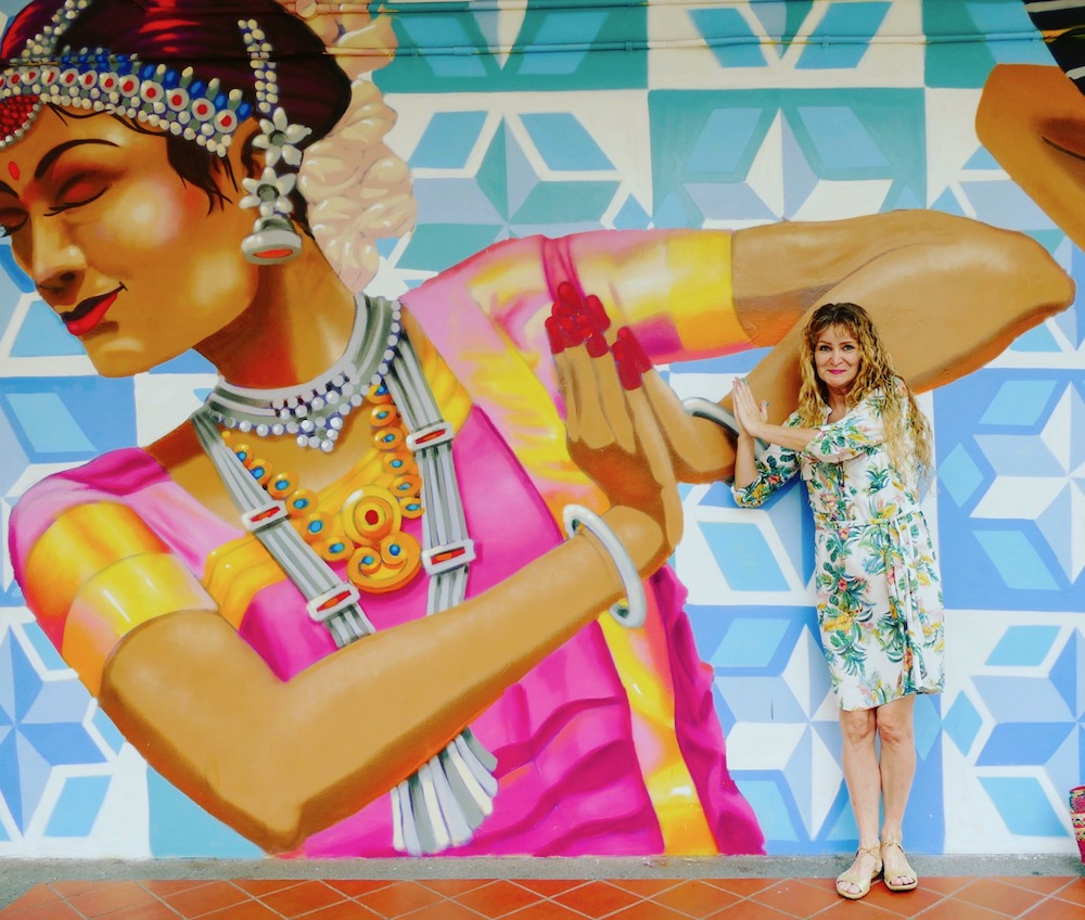 Woman next to Indian mural in Singapore |curlytraveller.com
