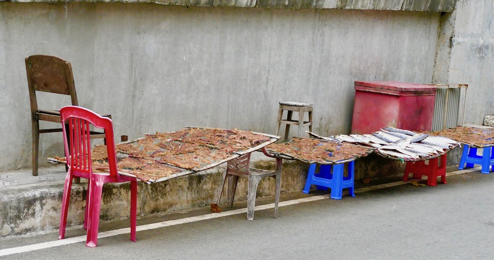 Drying fish near Duong Dong market |curlytraveller.com