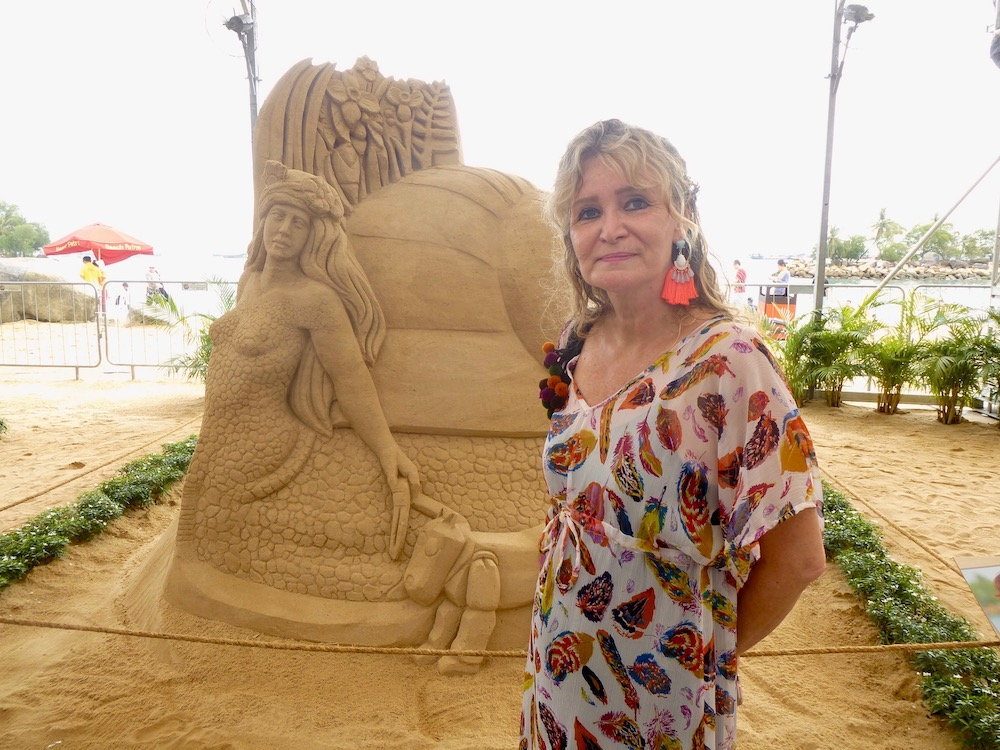 Woman in front of mermaid made out of sand on Sentosa Singapore |curlytraveller.com