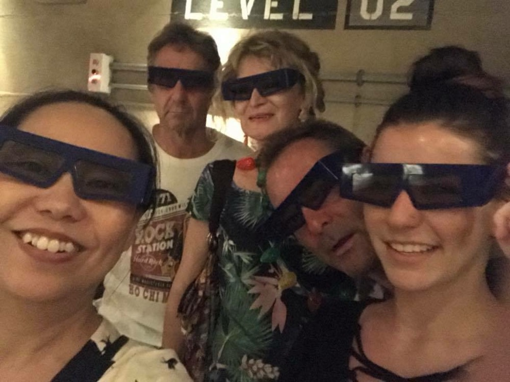 Group of people wearing 3D glasses |curlytraveller.com