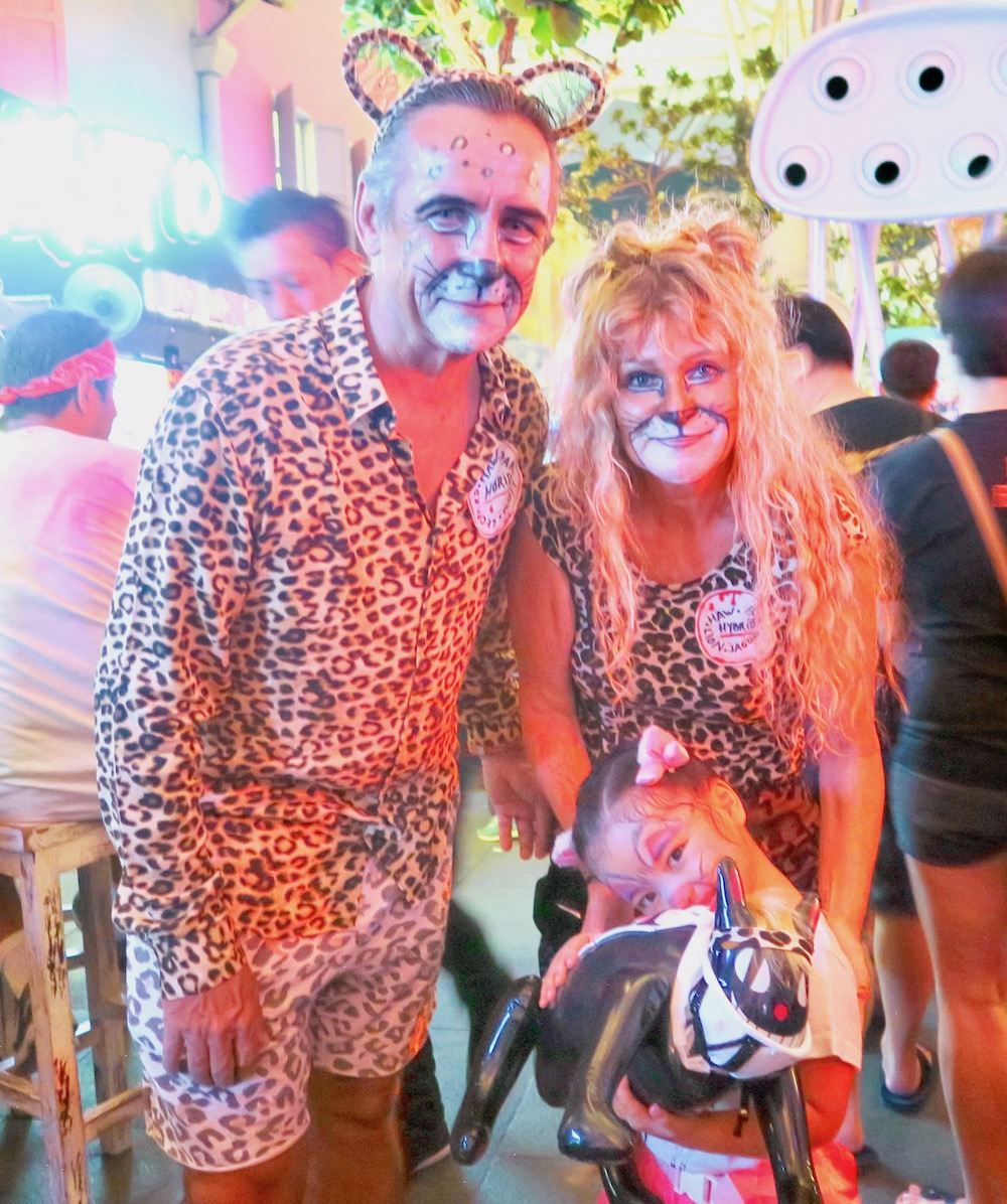 Couple and child during Halloween at Clarke Quay |curlytraveller.com