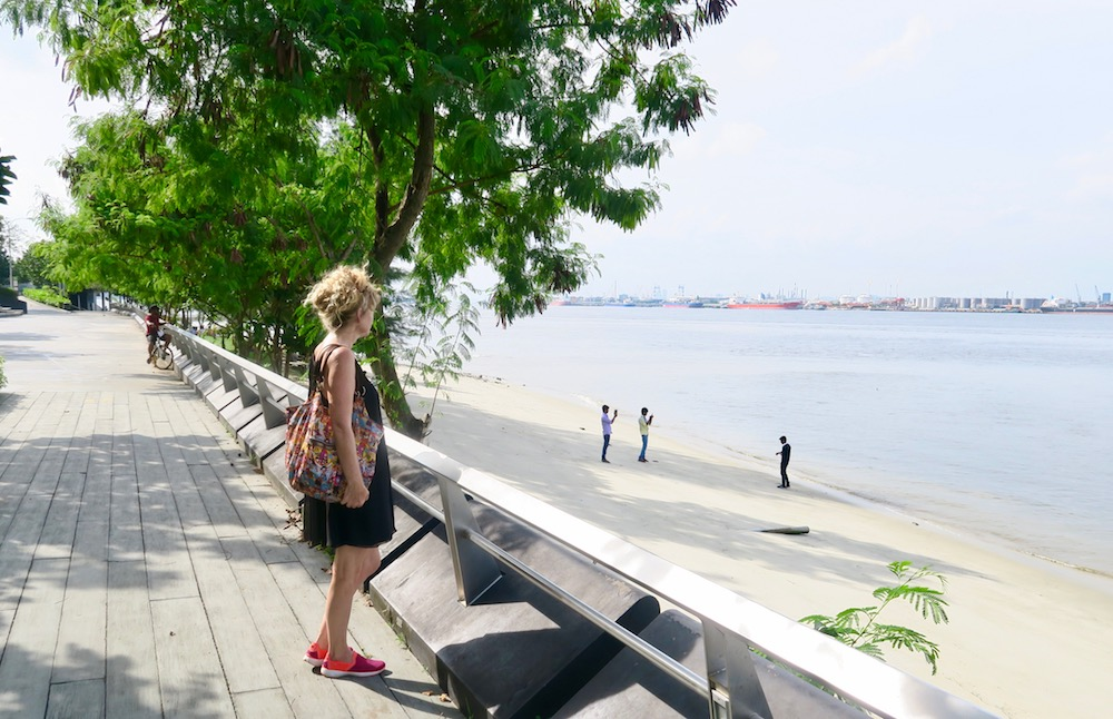 Woman looking out over the sea at Punggol |curlytraveller.com