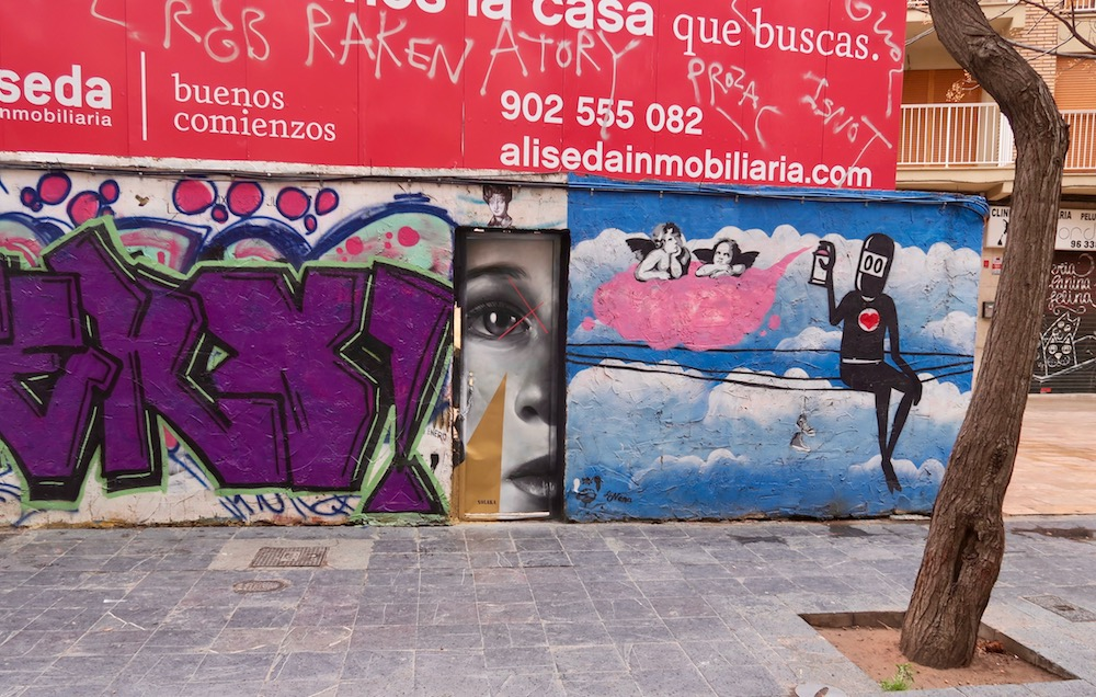 Wall with street art in Valencia |curlytraveller.com