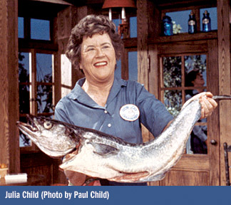Julia Child with huge fish in her arms