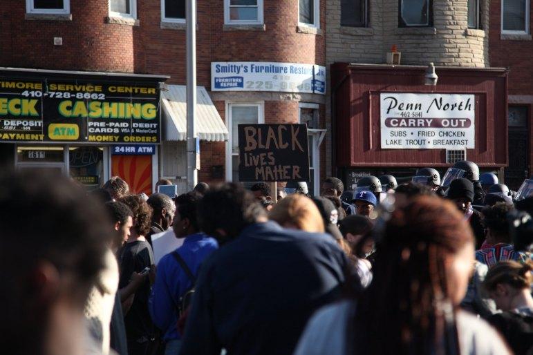 Protesters in Baltimore following the death of Freddie Gray. (Photo: Flickr/Arash Azizzada)
