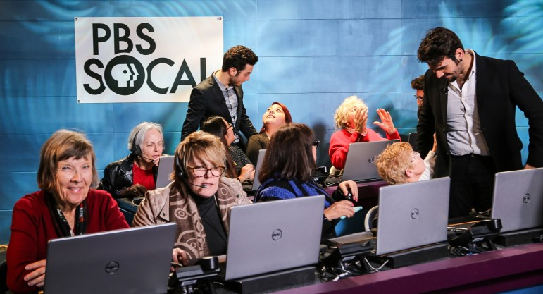 Gianluca Ginoble, center, and Ignazio Bochetto of the tenor trio Il Volo chat with volunteers during a PBS SoCal pledge event. (Photo: Heather Toner)