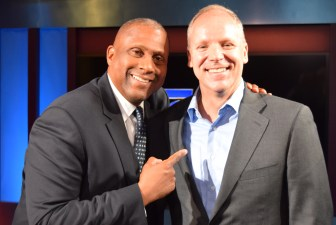 Talk show host Tavis Smiley, left, and Russell during a recent show taping in PBS SoCal's studios.