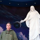 Scott Carrier poses with Jesus Christ scuplture at Temple Square's Visitor Center, Salt Lake City. Photo: Julian Cardona