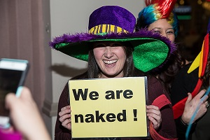 Girl with hat and sign that says we are naked - using CKE photo Booth !