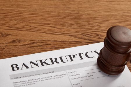 gavel on top of a paper filing for bankruptcy