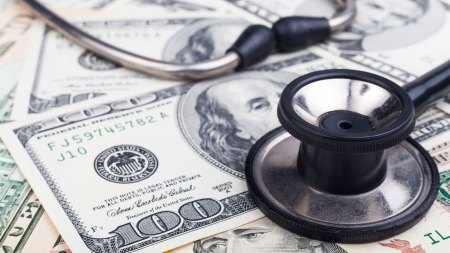 stethoscope over cash