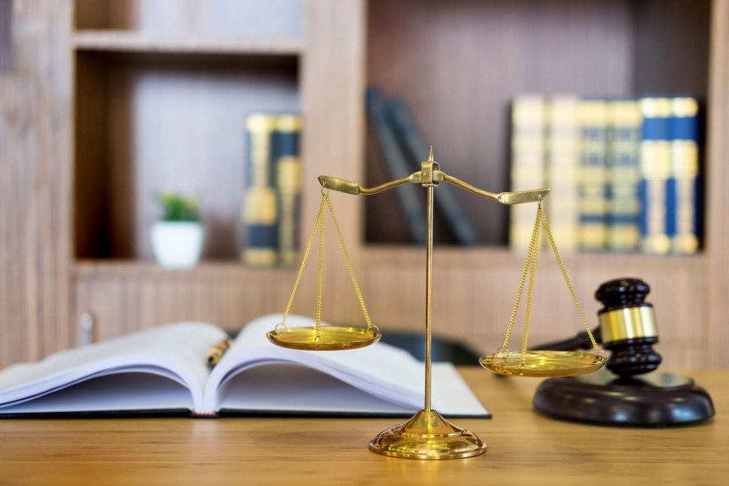 scale of justice on table with gavel